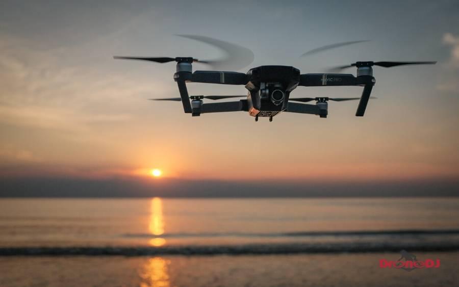 mavic pro drone hovering sunset